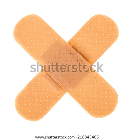 a plaster cross isolated over a white background - stock photo