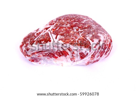A plastic bag filled with frozen raw beef mince. Image isolated on white studio background. - stock photo