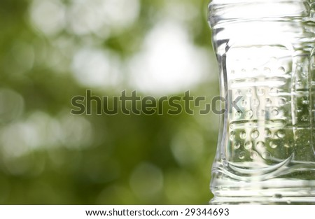 A plastic bottle against a green background.