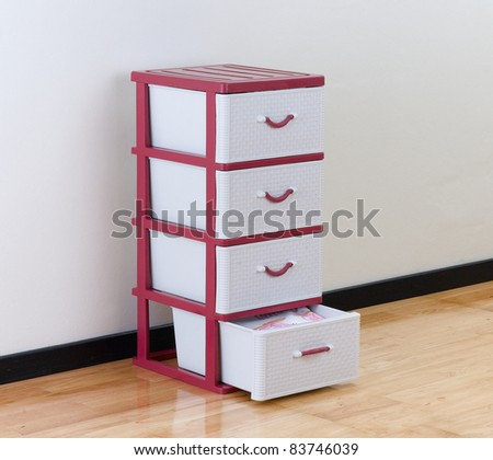A plastic cabinet with drawers for home or office using - stock photo