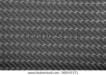 A plastic chair black basket weave pattern, for background