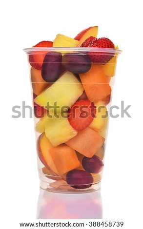 A plastic cup of fresh cut fruit. Isolated on white with reflection, fruits include, Strawberry, Pineapple, Apple, Cantaloupe, Honeydew and Grapes.