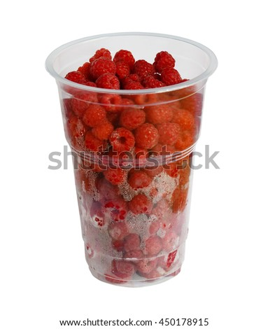 A plastic disposable cup with a raspberry. Isolation on a white background. Clipping path. - stock photo