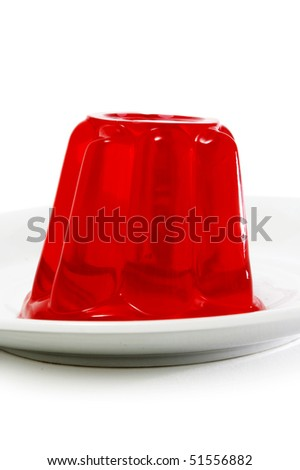 a plat with a red gelatin on a white background - stock photo