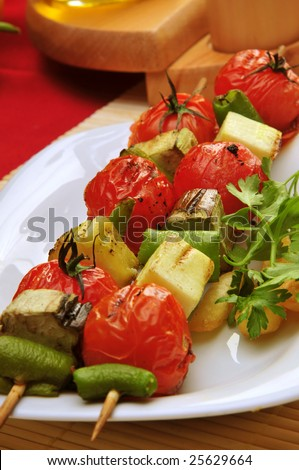 A plate full griled vegatables kabobs. - stock photo