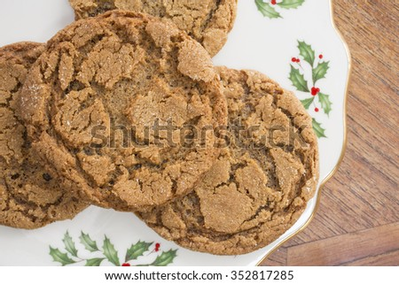 A plate full of home made ginger snap Christmas cookies from above. - stock photo
