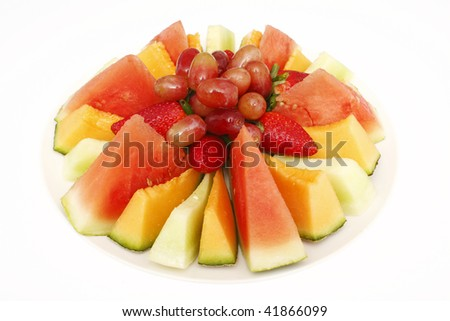 A plate of assorted freshly cut fruit.