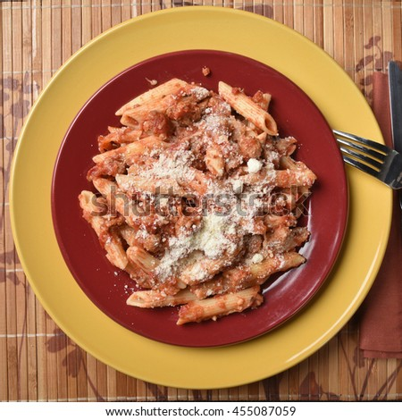 A plate of baked mostaccioli from an overhead view - stock photo