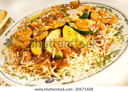 A plate of Chicken Primavera with pasta - stock photo
