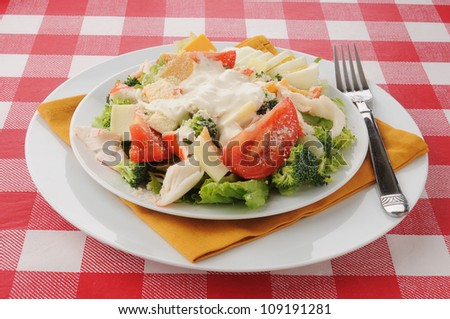 A plate of crab salad with cheeses