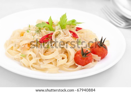 A plate of Fettuccine with cherry tomatoes and celery - stock photo