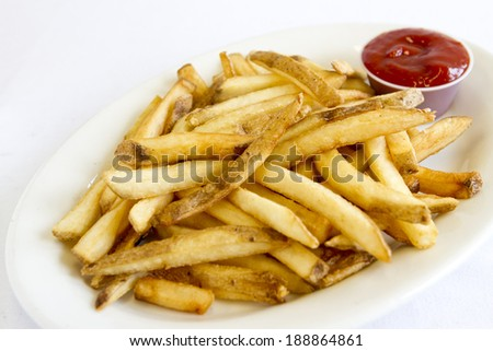 A plate of french fries. - stock photo