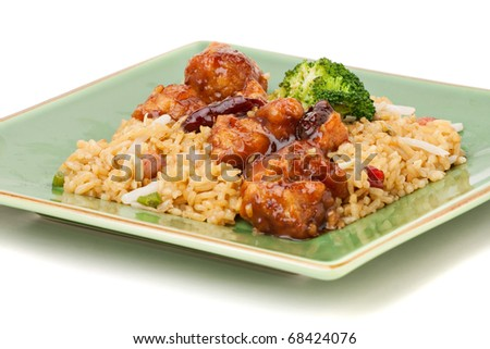 A plate of General Tso's chicken with broccoli and pork fried rice isolated on a white background. - stock photo