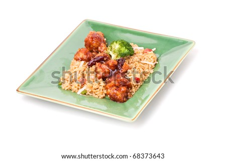 A plate of General Tsos chicken with broccoli and pork fried rice isolated on a white background. - stock photo