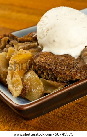 A plate of gluten free, organic apple cobbler with a scoop of ice cream - stock photo