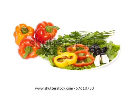 A plate of pepper, onion, feta, lettuce and three uncut peppers