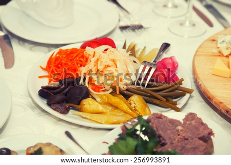 A plate of pickles in a restaurant - stock photo