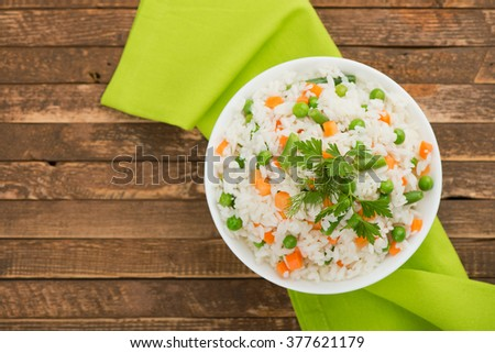 A plate of rice with vegetables. Selective focus. - stock photo