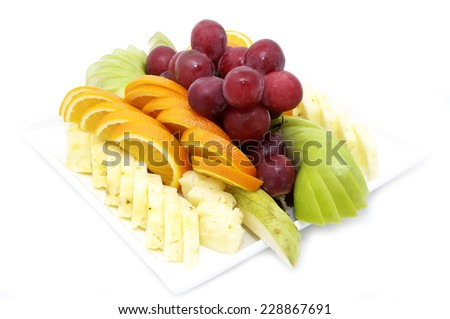 a plate of ripe juicy fruit on white background - stock photo