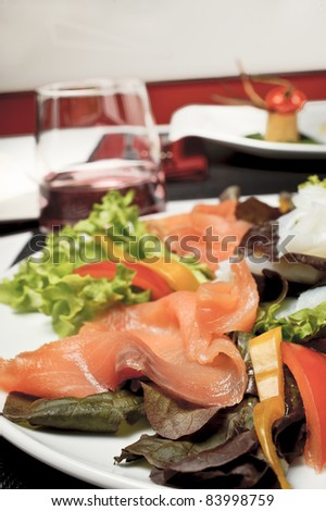 a plate of salmon with salad - stock photo