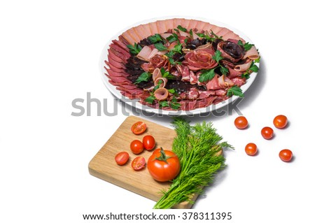 A plate of sausages with tomato and parsley