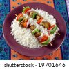 A plate of shashlik with rice - stock photo