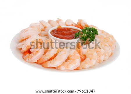 A plate of shrimp prawns with cocktail sauce on a white background - stock photo