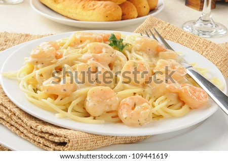 A plate of shrimp scampi with garlic butter sauce - stock photo