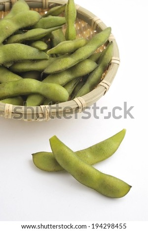 A plate of snow peas with two on the side. - stock photo