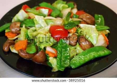 A plate of stir fired vegetables healthy dish - stock photo