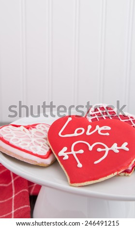 A plate of Valentine cookies on a cake stand - stock photo
