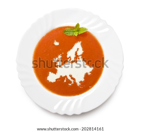 A plate tomato soup with cream in the shape of Europe.(series) - stock photo