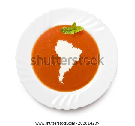 A plate tomato soup with cream in the shape of South America.(series) - stock photo