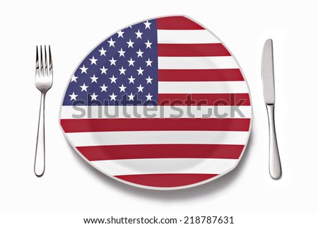 A plate with american flag and cutlery as a symbol for the American cuisine. - stock photo