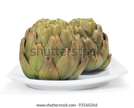 a plate with cooked artichokes on a white background - stock photo