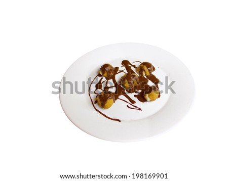 A plate with profiteroles and chocolat. Isolated in White - stock photo