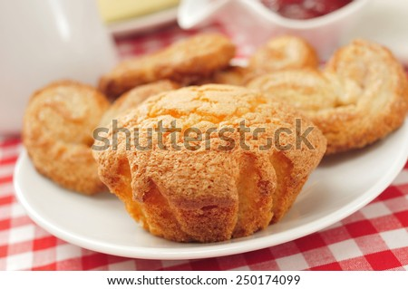 a plate with some magdalenas and palmeras, spanish plain muffins and palm trees, on a set table - stock photo