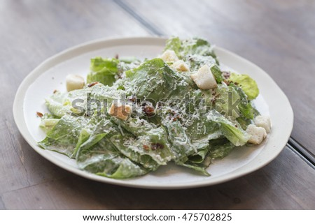 A plated Caesar salad.