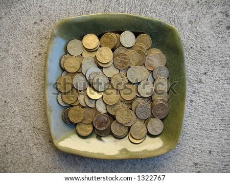 A plateful of one dollar Australian coins. - stock photo