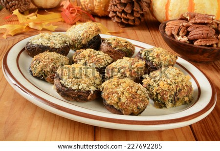 A platter of mushrooms stuffed with spinach, mozzarella, parmesan and fontina cheese - stock photo
