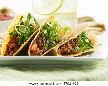 a platter of three tacos - stock photo