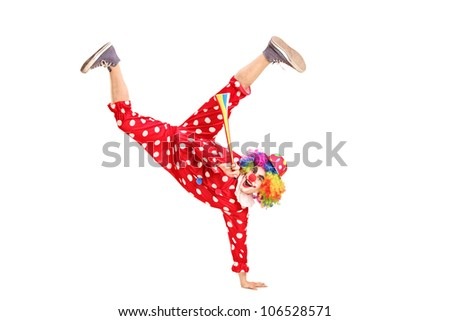 A playful clown with happy expression on face, holding a horn isolated on white background - stock photo