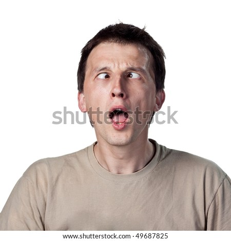 A playful face made by a young man - stock photo