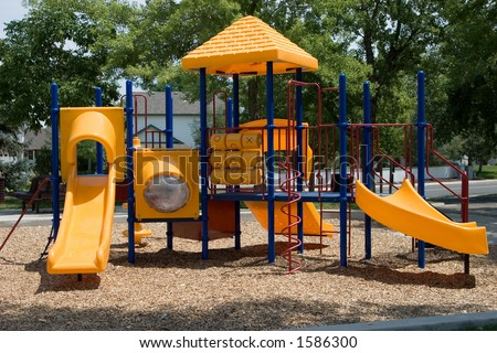 A playground built for young kids in primary colors of red, blue and yellow.