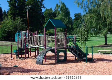 A playground set contains slides, jungle gyms, bridges and a climbing wall. - stock photo