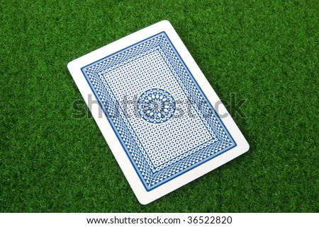 a playing card on green table