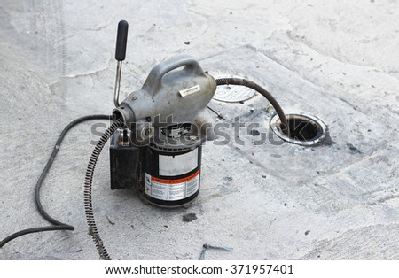 A plumber's snake machine .sometime known as a toilet jack - stock photo