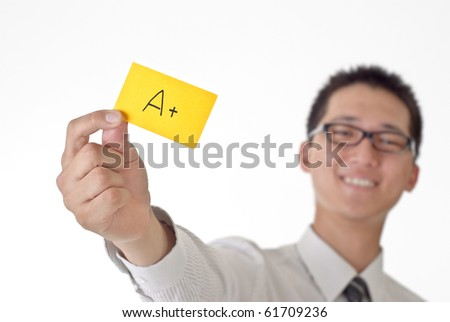 A plus graph on yellow card holding by Asian business man . - stock photo