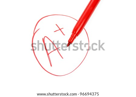 A plus on a test paper - stock photo