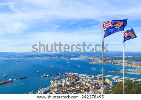 A pnaorama of Gibraltar city with Gibraltar's flags - stock photo